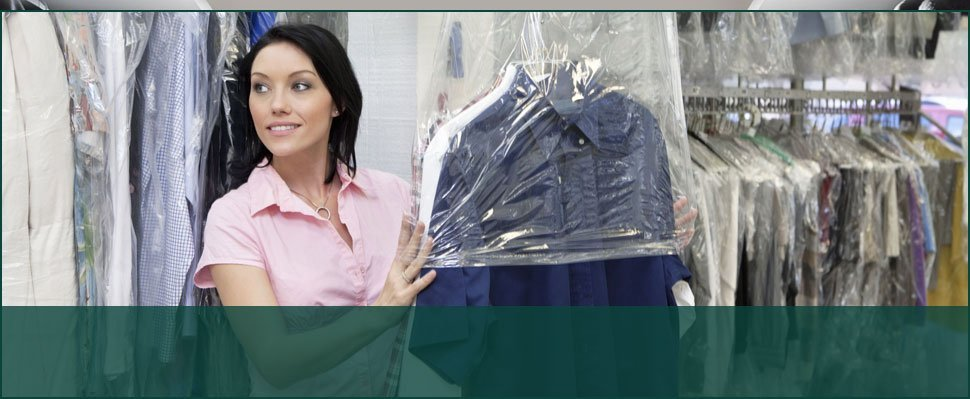 Woman wrapping clothes in plastic
