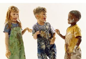 Three kids with stained clothes