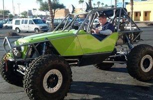 Man riding a green 4x4 truck