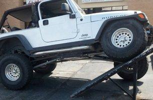 White 4x4 truck