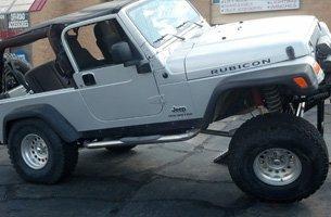 A off balance white 4x4 jeep