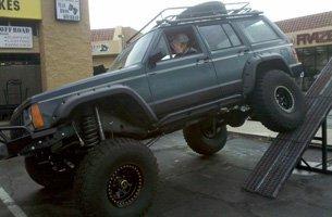 A man driving a big 4x4 jeep