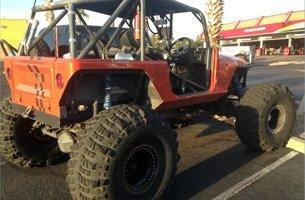 A dusty 4x4 jeep