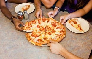 People sharing a pizza