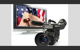 A camera and a television on a white background