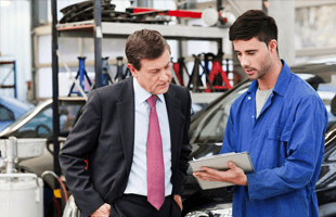 Man Taking An Estimate For A Auto Repair