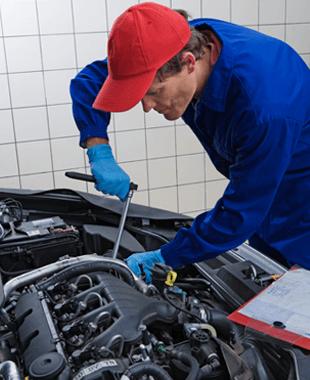 Man Repairing An Auto