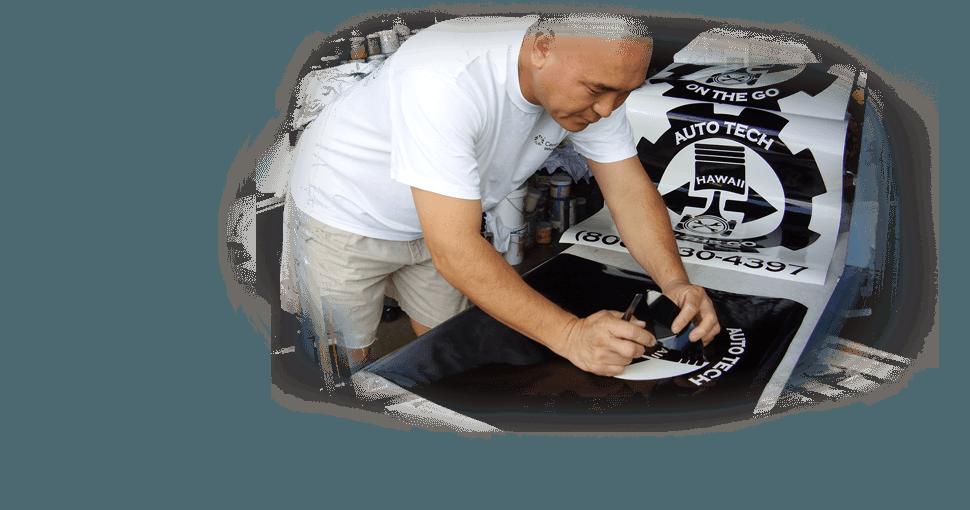 Man tracing graphics on shirts