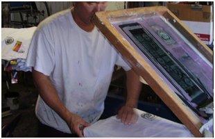 Man printing shirts