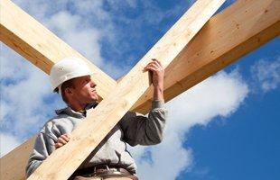 Man checking a lumber