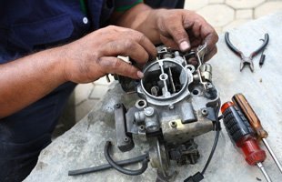 Technician repairing car part