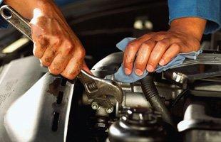 Man repairing engine of car