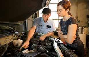 Man checking up womans car