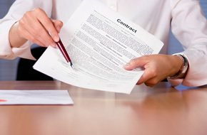 An employee is showing a signed job contract