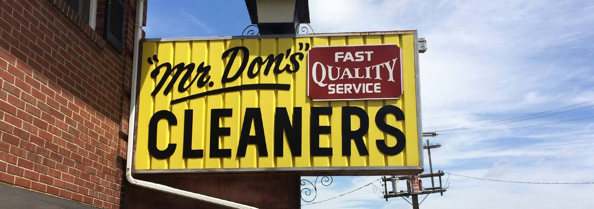 Mr. Don's Cleaners Inc. sign board