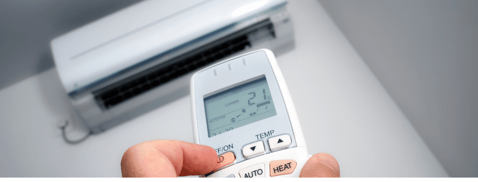 Person operating the AC with remote control