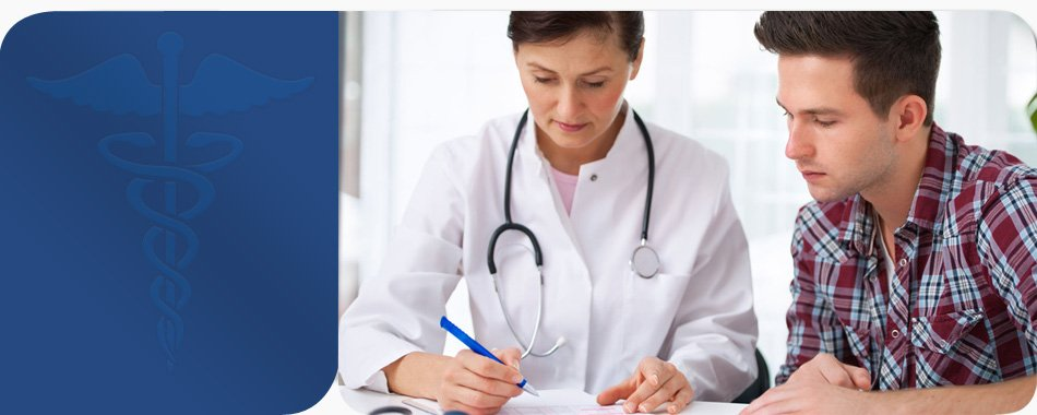 Doctor writing on paper with the patient