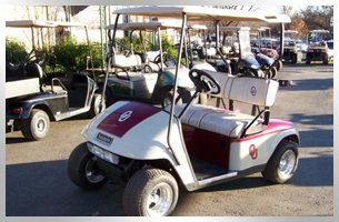 Pink and white golf car