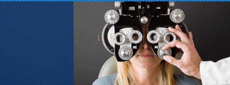 Woman on eye machine check up
