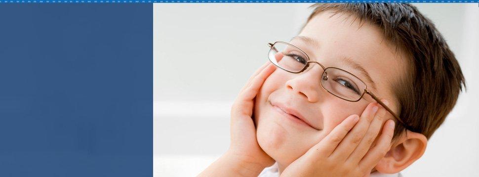 Boy smiling with eyeglasses