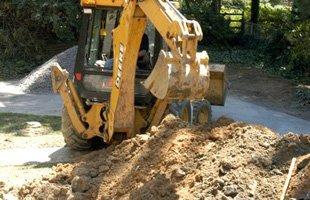 backhoe digging the soil