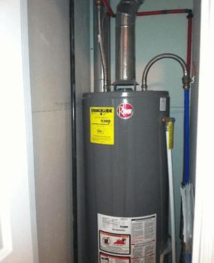 plumber repairing heater