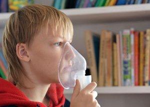 little boy oxygen mask