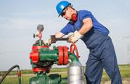 Repair man fixing a pump