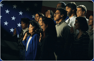 a group of people facing the american flag