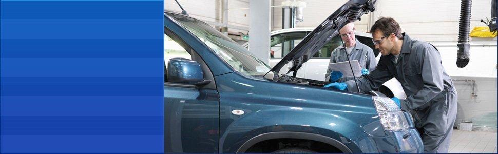Auto technician checking car engine