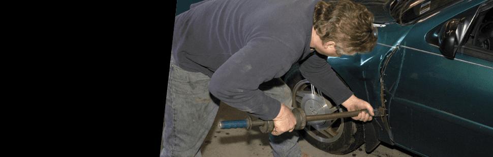 Man removing dent