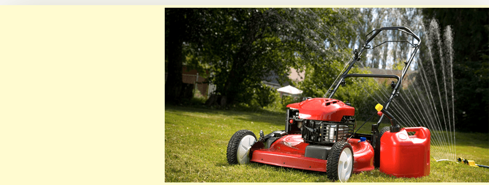 Red lawn mower on grass