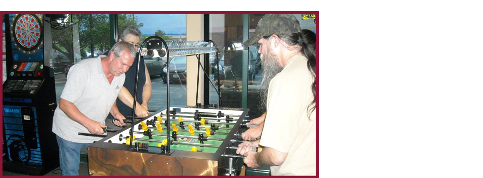 Two white man playing guitar and organ