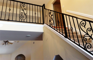Wrought iron indoor railings on stairway