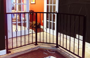 Black painted indoor metal fence