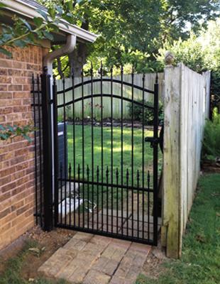 Short iron garden gate in the backyard