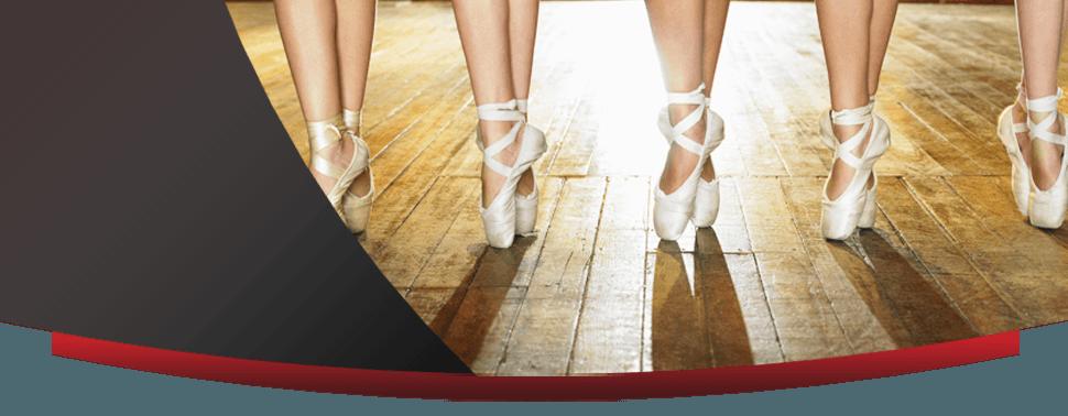Line of ballet dancers on the floor