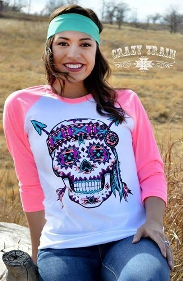 Women in pink skull shirt