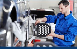 mechanic repairing auto part