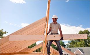 contractor installing wood panels