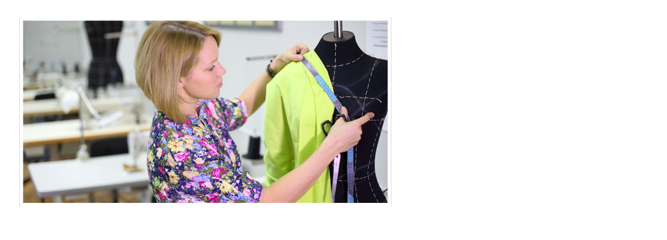 Female tailor measures sizes on black mannequin with light green clot