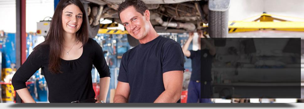 Auto mechanic smiling