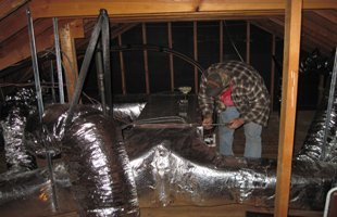 HVAC contractor doing an inspection