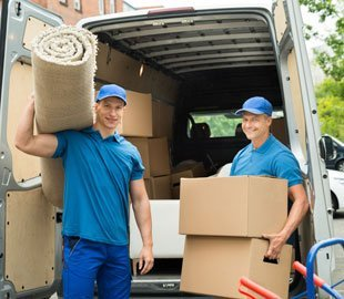 Men Moving Boxes And Carpet
