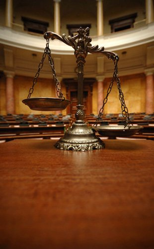 A gold justice scales inside the court