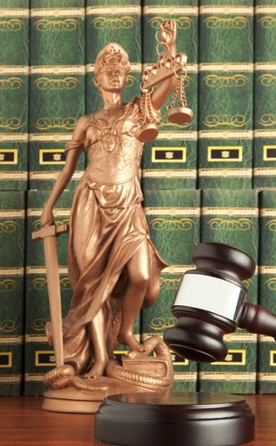 The legal books, gavel and the lady justice in the law office