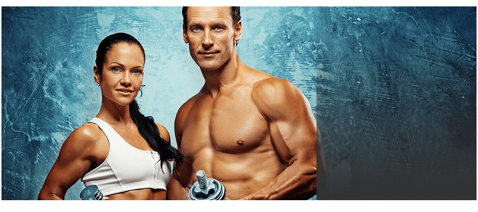 Muscular man and woman with dumbbells