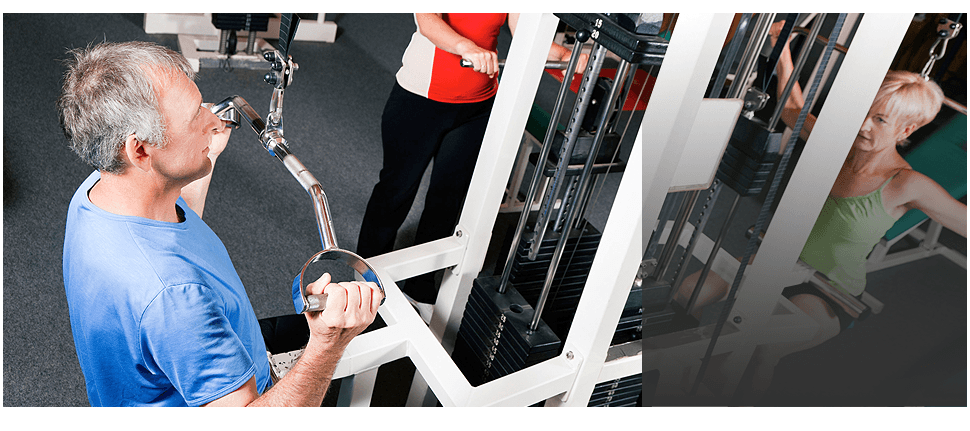 Older man and woman on a strength machine