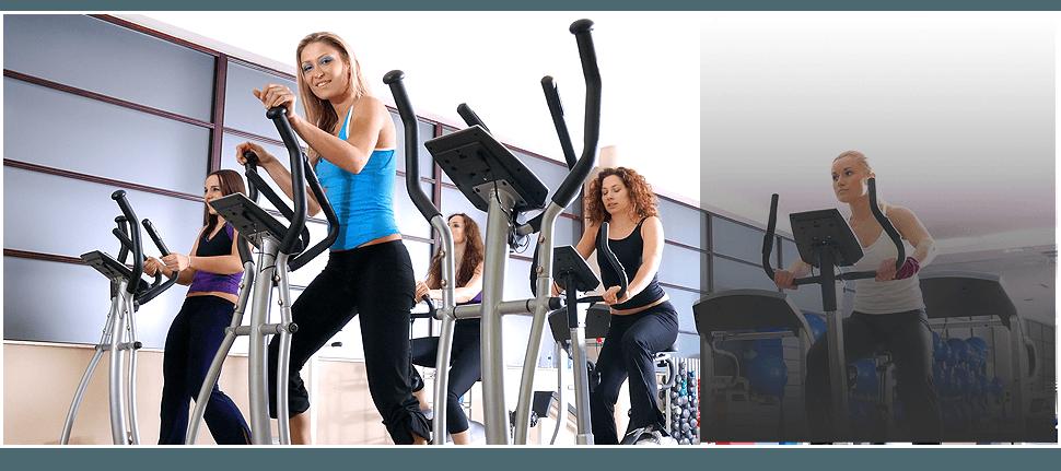 Women on an elliptical equipment