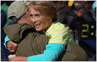 Man hugging an older woman